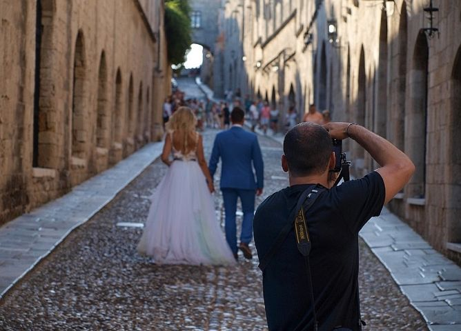 wedding photographer taking photos of the bride and groom