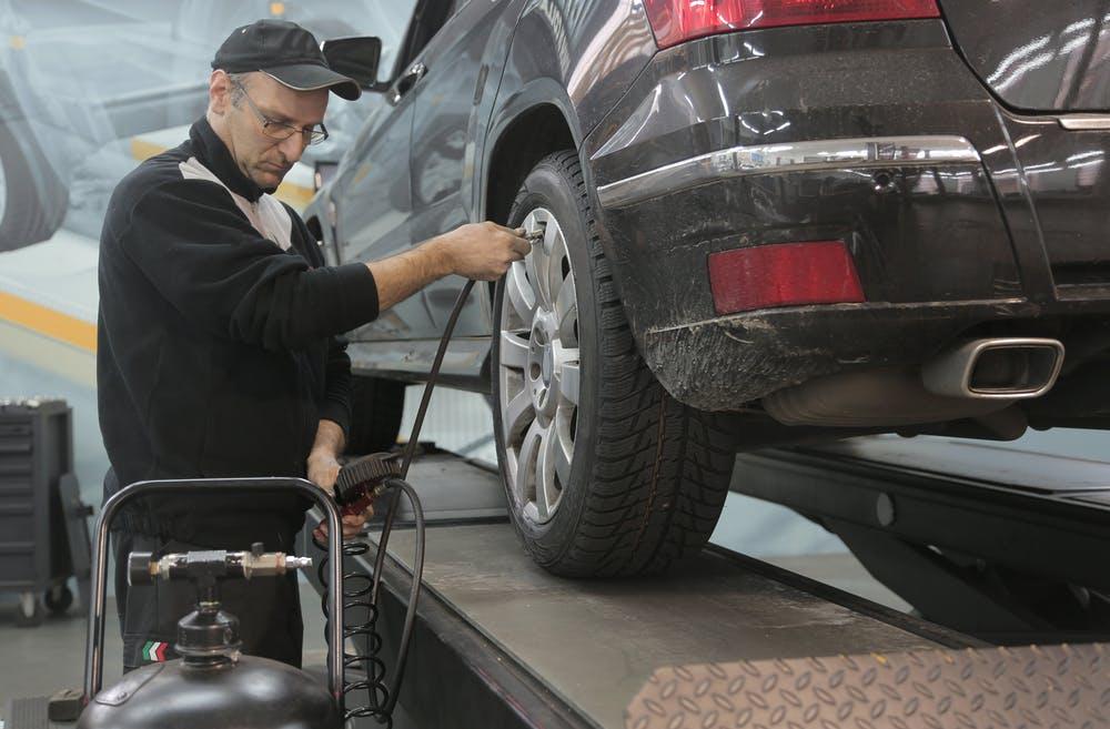 mechanic repairing a car in the shop